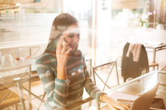 Young woman having a phone call Stock Image