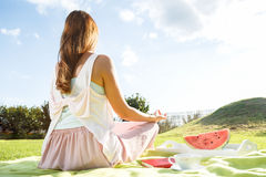 Young woman having picknic in park Royalty Free Stock Images