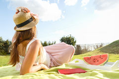 Young woman having picknic in park Stock Photo
