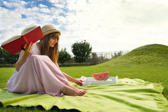 Young woman having picknic in park Royalty Free Stock Photo