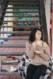 Young woman having picnic: drinking tea and reading book Royalty Free Stock Photography