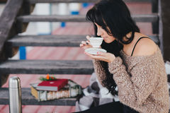 Young woman having picnic: drinking tea and reading book Royalty Free Stock Photos