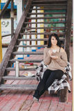 Young woman having picnic: drinking tea and reading book Royalty Free Stock Photo