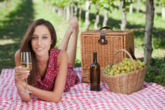 Young woman having a picnic Royalty Free Stock Image