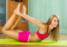 Young woman having pilates indoor Royalty Free Stock Photos
