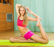 Young woman having pilates indoor Royalty Free Stock Image