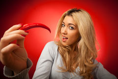 Young Woman Having A Red Hot Chilli Pepper Royalty Free Stock Image
