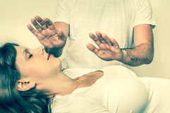 Young woman having reiki healing treatment - retro style Stock Images