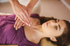 Young woman having a reiki treatment Stock Photo
