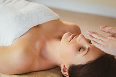 Young woman having a reiki treatment Stock Image