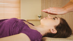 Young woman having a reiki treatment Royalty Free Stock Images