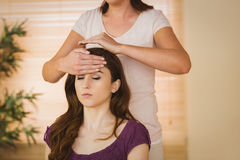 Young woman having a reiki treatment Royalty Free Stock Image