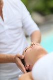 Young woman having a relaxing facial massage Stock Image