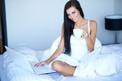 Young woman having a relaxing morning Stock Images