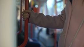 Young woman having ride in metro carriage, everyday commuting routine, railroad. Stock footage stock footage