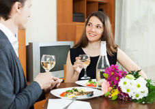 Young woman having romantic dinner with guy Stock Images