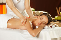 Young woman having a shoulder massage Royalty Free Stock Photo