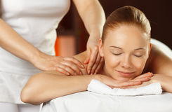Young woman having a shoulder massage Royalty Free Stock Photography