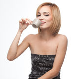 Young woman having a sip of coffee Stock Photo