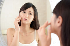 Young woman having skin problems Royalty Free Stock Image