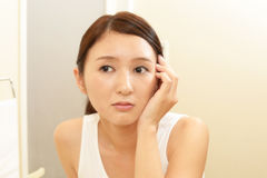 Young woman having skin problems Royalty Free Stock Images