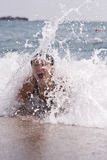 Young woman having some fun in ocean waves. Young happy woman swimming and having some fun in ocean Royalty Free Stock Photo