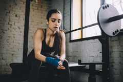 Young woman having some rest after hard workout in gym. Royalty Free Stock Photo