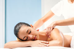 Young woman having spa back massage. Royalty Free Stock Images
