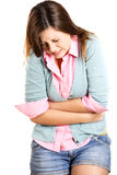 Young woman having stomach ache isolated on a white background Royalty Free Stock Photos