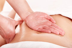 Young woman having stomach massage. Stock Images