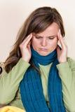 Young woman having a strong headache Stock Photos