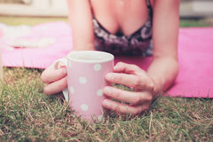 Young woman having tea outside Royalty Free Stock Photography
