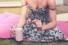 Young woman having tea outside Stock Photos