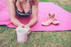 Young woman having tea outside Royalty Free Stock Image