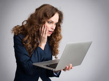Young woman having trouble with laptop Royalty Free Stock Photo