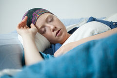 Young woman having tumor sleeping. Close-up of young woman having tumor sleeping royalty free stock photography