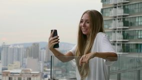 Woman Talking Online. Young woman having video chat on holidays.Happy female tourist girl waving at webcam on mobile phone camera, sharing summer travel vacation stock footage