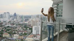 Woman Talking Online. Young woman having video chat on holidaysHappy female tourist girl waving at webcam on mobile phone camera, sharing summer travel vacation stock video