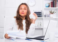 Young woman having work troubles in office Stock Image