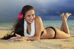 Young woman at a hawaii beach Stock Photo