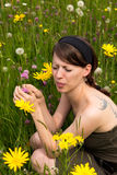 Young woman with hay fever in a wildflower meadow Royalty Free Stock Photo