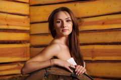 Young woman in a hayloft Stock Photo