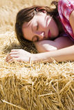 Young woman in haystack Royalty Free Stock Photos