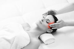Young woman on a head massage therapy. Healthy Beautiful Woman Spa. Recreation Energy Health Massage Healing Concept royalty free stock photos
