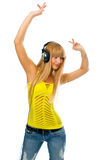 Young woman in head phones. Young woman listening music in head phones Stock Images