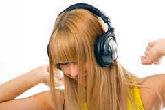 Young woman in head phones. Young woman listening music in head phones Royalty Free Stock Images