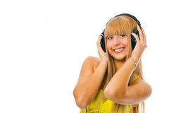 Young woman in head phones. Young woman listening music in head phones Royalty Free Stock Photo