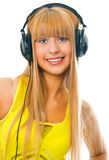 Young woman in head phones. Young woman listening music in head phones Stock Photos