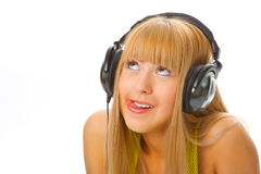 Young woman in head phones. Young woman listening music in head phones Stock Photo