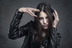 Young Woman with head phones listening to music Royalty Free Stock Images